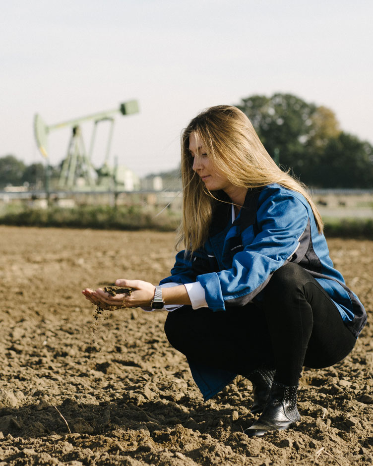 girl on a field examining probes